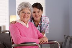 elderly woman smiling with her caregiver