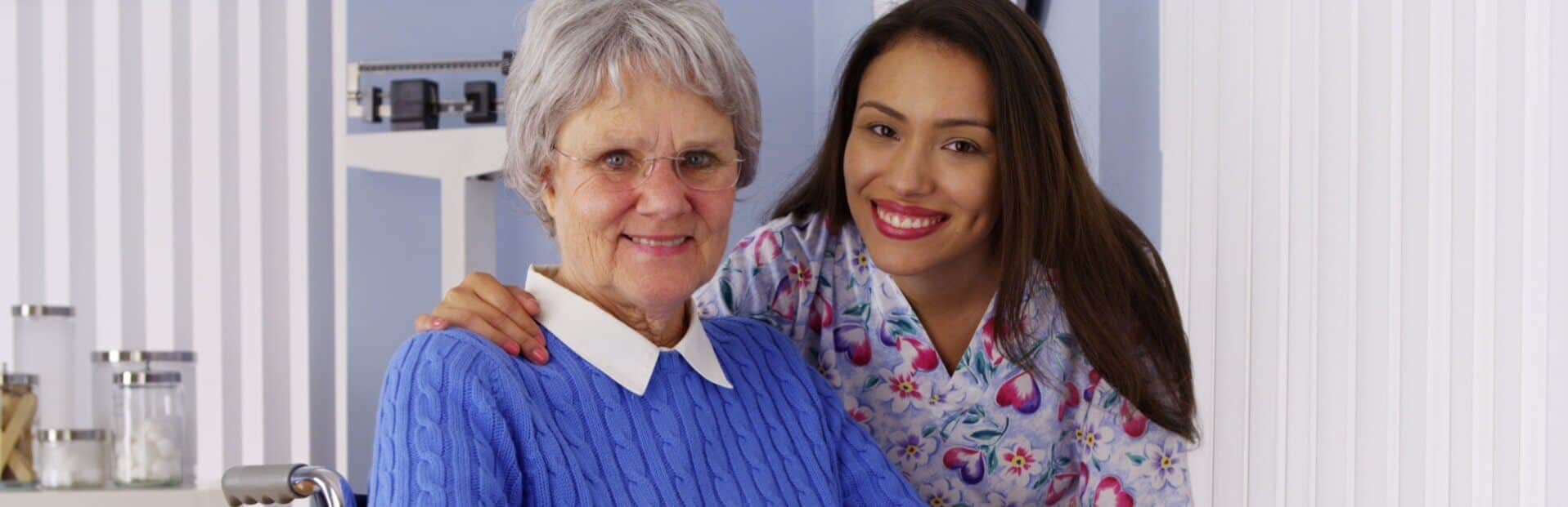 caregiver with old woman