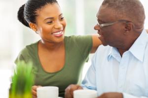 caregiver assisting elderly man in eating